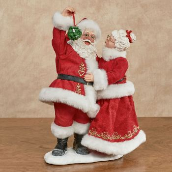 Mistletoe Kisses Clothtique Santa Figurine
