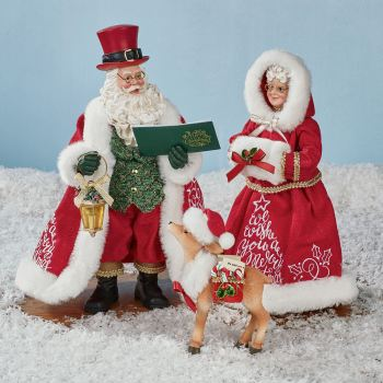 A Merry Christmas Clothtique Santa Figurine Set