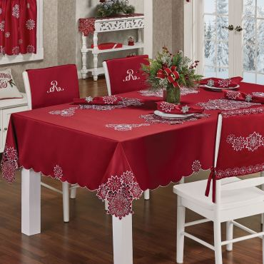 Dining room setting with red holiday table linens
